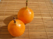 Two grenadilla fruit Royalty Free Stock Image