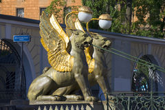 The two griffins on the Bank bridge with an odd side of the canal. Saint Petersburg Stock Image