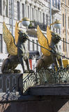 The two griffins on the Bank bridge with an odd side of the Griboyedov canal. Saint Petersburg Stock Photography