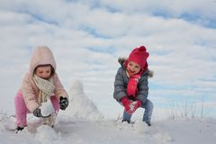 Two cute grill in the snow. stock image