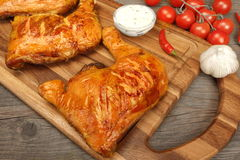 Two Grilled BBQ Chicken Leg Quarter On Wood Board Stock Photos
