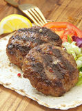 Two grilled burgers and salad Royalty Free Stock Images