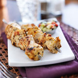 Two grilled chicken skewers Stock Images