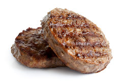 Two grilled hamburger patties on white. Two grilled hamburger patties  on white Stock Photography