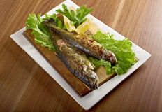 Two grilled Rainbow Trouts. Served with Vegetables stock photos