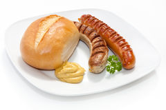 Two Grilled Sausage with mustard, bread Stock Photo