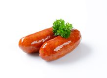 Two grilled sausages. On white background stock photos