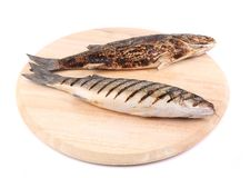 Two grilled seabass fish on platter. Stock Photos