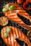 Two grilled steak red fish salmon and vegetables on the grill Royalty Free Stock Photos