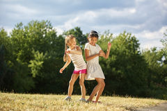 Two grils dancing in summer Royalty Free Stock Photography