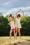 Two grils dancing Stock Image