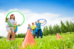 Two group of kids playing with hula hoops Royalty Free Stock Photo