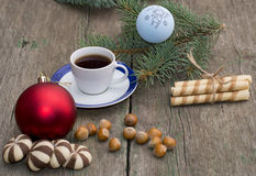 Two groups of cookies, coffee, Christmas tree decorations and co Royalty Free Stock Photography