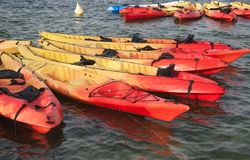 Two groups of kayaks close to each other stock photography