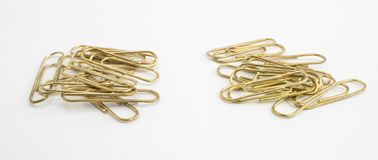 Gold Paper Clip Battle Royalty Free Stock Photography