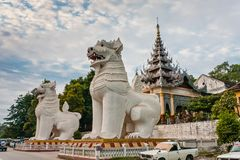Two guard leogryphs stylised lion figures at the southern entrance to Mandalay Hill. Mandalay Hill is a 240 metres hill that is located to the northeast of the royalty free stock image