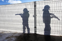Two Guardians. Are holding there Weapons in the Sun Stock Image