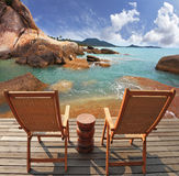 Two guest sun loungers on a wooden platform Stock Photography