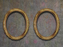 Two guilded frames on old wallpaper Royalty Free Stock Image
