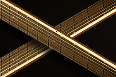 Guitar Necks crossing. Two guitar necks crossing each other Royalty Free Stock Image