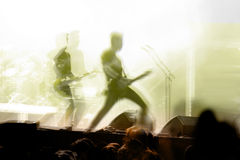 Guitar solo in concert with crowd. Two Guitar solo in concert with crowd royalty free stock photography