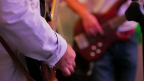 Two Guitarists Playing Guitar . Close-up. Close up of two musicians playing the guitar in band stock footage