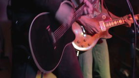 Two guitarists on the stage. Musicians playing on a concert stock video