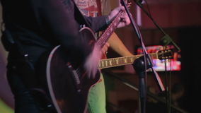 Two guitarists on the stage. Musicians playing on a concert stock video footage