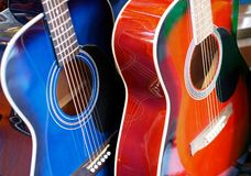 Two Guitars. On the stand Stock Image