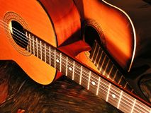 Two guitars. New and old acoustic guitar stock image
