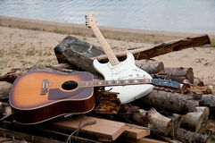 Two guitars on the beach Royalty Free Stock Images