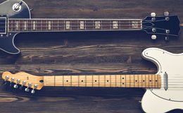 Two guitars. Two guitars on a dark wooden board Royalty Free Stock Photos