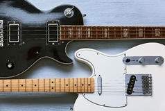 Two guitars on a light wooden board. Top view Stock Image
