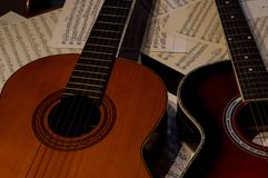 Two guitars one acoustic and another spanish. stock images