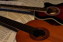 Two guitars one acoustic and another spanish. stock image