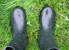 Two gumboots on the grass Royalty Free Stock Photography