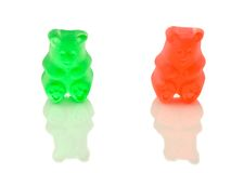 Two Gummy Bears. A macro shot of two gummy bears over a white background Stock Image