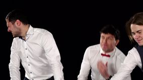 Two guys are betting in a casino. Black. Two guys are betting in a casino, two guys are betting and losing, white shirts, formal look, red butterfly, cam moves stock video