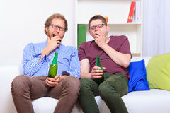 Two guys on boring party at home Royalty Free Stock Photography