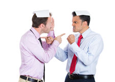 Two guys, businessman, a boss and employee, angry pointing fingers at each other and blaming for problems Stock Image