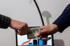 Two guys or businessmen trade exchange folded dollars from hand Stock Image