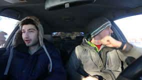Two guys in the car dancing modern dances in the winter. stock footage