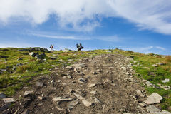 Two guys climbers climb to the summit of Mount. Hoverla Royalty Free Stock Photo