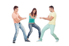 Two guys competing for a girl pulling a rope. Isolated on a white background Royalty Free Stock Image