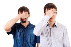 Guys close the Eyes. Two Guys Cover the Eyes on the White Background royalty free stock photography
