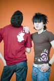 Two Guys, Dreamstime Shirts. Two guys wearing dreamstime shirts, one facing to rear, the other facing forward, hadn on shoulder Royalty Free Stock Photo