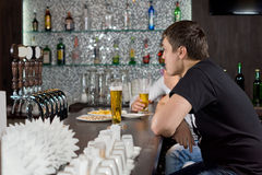 Two guys drinking at a bar Royalty Free Stock Photo