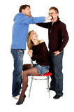 Two guys fight in front of a sitting prety girl Stock Images