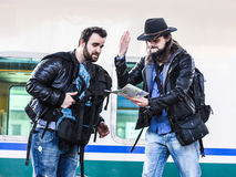 Two guys are fighting because they are lost in a foreign country. Royalty Free Stock Photo