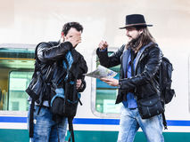 Two guys are fighting because they are lost in a foreign country. Stock Images
